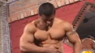 Latin male bodybuilder pose naked