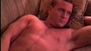handsome straight guy strokes his cock
