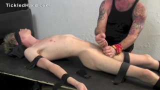 young blond gets tickled