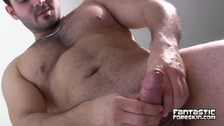 handsome beefy cub plays with foreskin