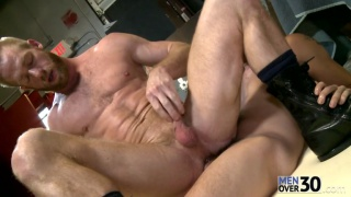 redhead hunk sits on a large dick