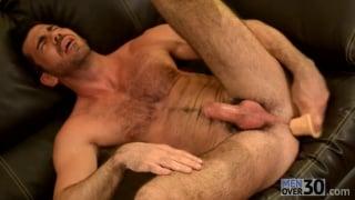 handsome furry hunk shoves dildo up his ass