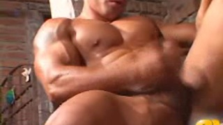 Muscular guy jerks and shows off
