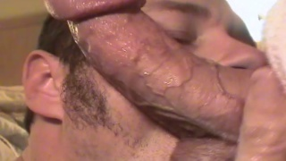 cocksucker swallows big curved dick