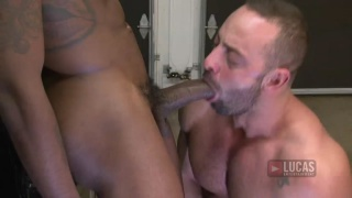 mega-hung bottom riding a huge black cock