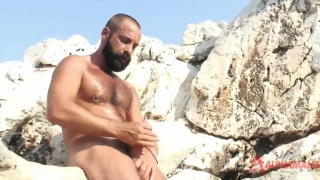 Bearded gay bear jerking off outdoors