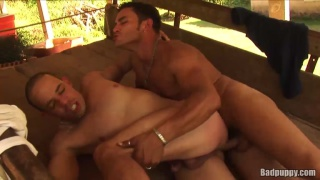 latin top bends over his buddy outside