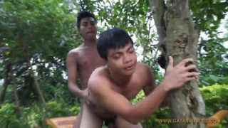 asian bottom holds a tree while getting fucked
