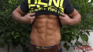 Professional ripped model shows off