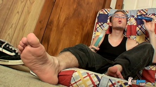 bare-footed billy plays with his hard dick