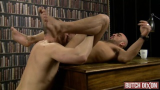 bald power bottom rides dick in library