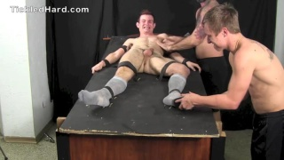 hot guy strapped to table and tickled