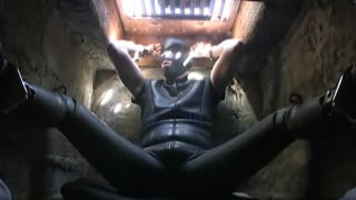 sub strapped in full-body suit and confined underground