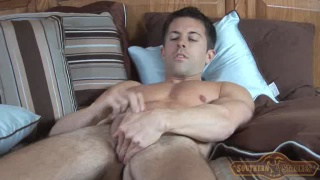 jacking off with a glass dildo up his butt