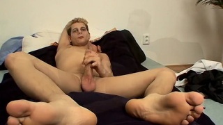 honza strokes his uncut dick and cums on his bare feet