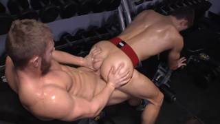 bottom in red jockstrap gets fucked in gym