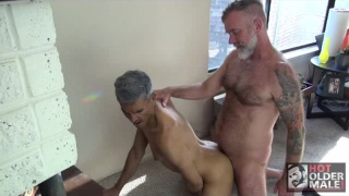 older man jack finds thor naked by the fireplace