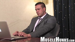 muscle daddy wanks off in his office