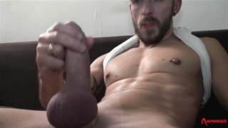 bearded French man strokes his dick