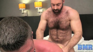 bottom happily gives his ass to this hairy top