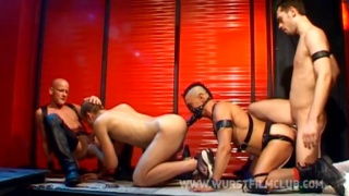 4 leathermen in handballing fourway
