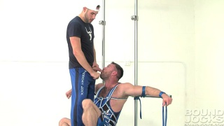bound aaron cage in blue wrestling singlet