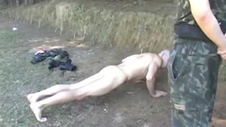 latino soldier bends over for his CO
