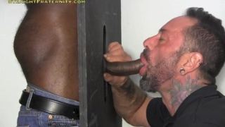 sucking a big black dick at the glory hole