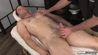 beefy navy hunk gets stroked on massage table