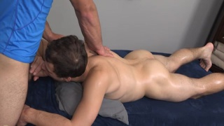 servicing his masseur right on the table