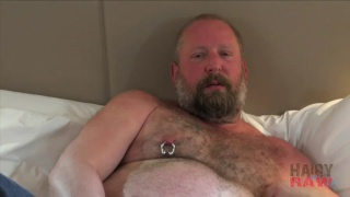 bearded daddy with huge belly stroking his cock