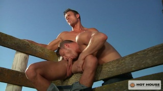 brian bonds blows ryan rose on a farm fence