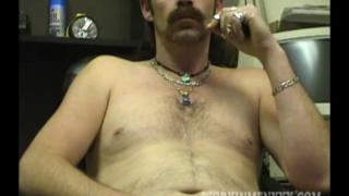 amateur biker strokes his meaty uncut cock