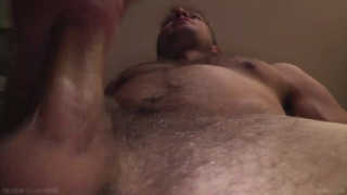 blond stud jacking his uncut cock