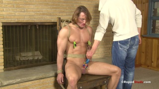 bound blond hunk gets cock and balls clamped