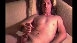 long-haired redneck unloads on his belly