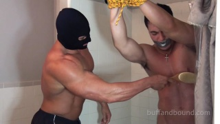 bodybuilder tied up and showered