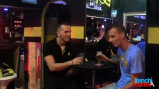 french guys enjoying a drink together