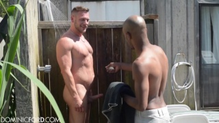 Hans Berlin and James Key in outdoor shower