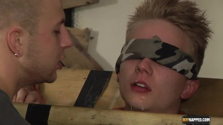 Blond boy Corey naked and hanging in the stocks