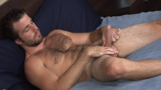 sexy bearded and hairy dude jacking his dick
