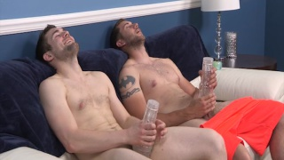 horny guys fleshjacking together on a bed