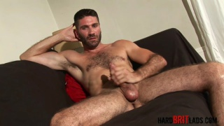 handsome and hairy Craig pulls his cock