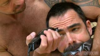 Brock Hatcher shaves Dolan Wolf's head
