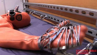 sub has hands secured in stainless steel hand cages