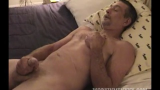 old koot strokes his big uncut cock