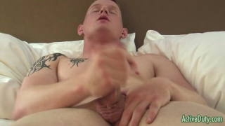 military lad stroking his cock