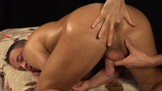 handsome hunk gets his hole played with on massage table