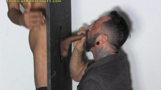 max moseys up to the glory hole with his big uncut cock