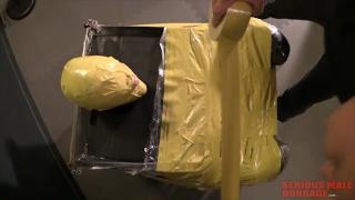 sub mummified in yellow duct tape